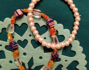 2 bracelets: One multi-colored bead and one faux pearl  Happy Valentines Day !