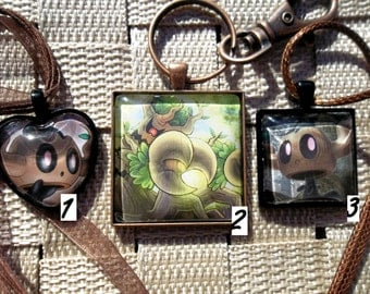 Phantump and Trevenant glass pendant made from trading cards