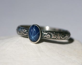 Medium Oval Blue Star Sapphire and Sterling Silver Ring on Vine Pattern Band in Antique Silver Finish