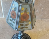 Vintage Glass tea lamp shade with dried flowers and metal stand.