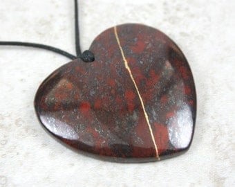 Kintsugi (kintsukuroi) brecciated jasper stone heart pendant with gold repair on black cotton cord - OOAK