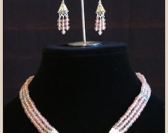 Necklace and Earrings Set:  Cherry Quartz triple strand necklace and triple drop earrings.  Silver Metal spacers and Earring triangles.
