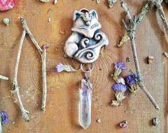 Electroformed adorned fox with a hanging angel aura quartz crystal