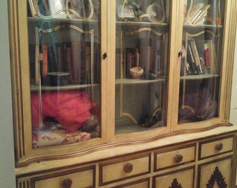 Vintage china cabinet with gold accents