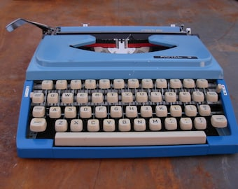 Vintage Royal Century Working Blue Typewriter with Blue Hard Top and Carrying Strap