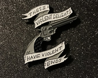 "Westworld Inspired Gun and banner, ""These violent delights have violent ends."" Soft enamel pin / button."