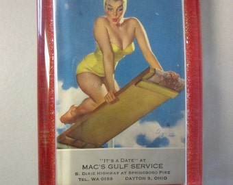 "4.25"" x 2-7/8"" Glass Block Paperweight, 1940s Pinup Girl IT'S A DATE, Mac's Gulf Service, Dayton Ohio (1940s) by Gil Elvgren"
