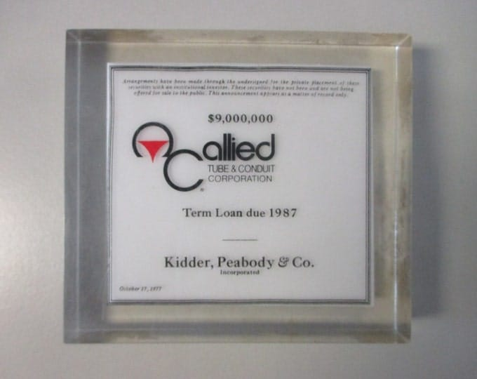 """4.5"""" x 5"""" Paperweight Lucite Double-Sided Block, Allied Tube and Conduit - Kidder, Peabody & Co., 1977 - 9,000,000 dollar term loan"""