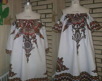 African Clothing for Women: N Y O T A African  Print Dress in White (bishop sleeve left flutter sleeve right pic)