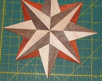 "Walnut, maple and padauk 8-point star inlay medallion. 5-1/2"" wide."