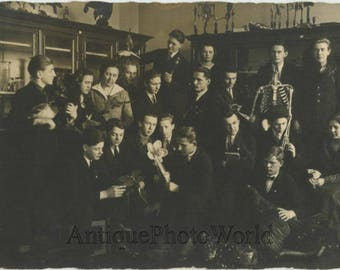 Science class students w taxidermy birds and skeleton antique rppc photo