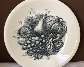Wedgwood plate decorated with illustration of fruit. Freedom from Hunger Campaign.