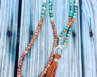 Sale !!! 39.99 was 59.99 Leather Tassel/ Beaded african Turqouise bead necklace /Rosewood necklace / Long Necklace
