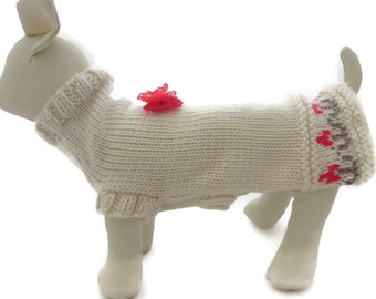 Dog Sweater hand knitted in cream with a flower garden design and a pretty bow.
