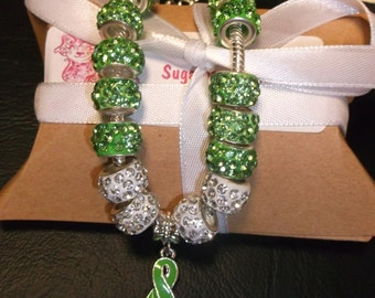 Silver Lyme Disease Green Ribbon Bracelet, Green Crystal Lampwork beads and white crystal beads, 7.5 inches adjustable sugarbearproductions