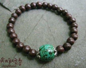 Rosewood Bracelet Mala with capped turquoise guru bead purified & blessed mala