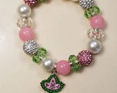 """Arm Candy. """"Envy the Ivy"""" AKA inspired charm/beaded bracelet . Pink and Green. Alpha Kappa Alpha"""