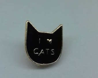 A fun and quirky 'I love cats' black enamel brooch pin