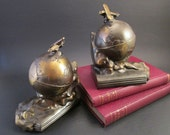 1930s Art Deco Bookends, Globe and Airplane, Bronze Clad Metal, Signed K & O Kronheim and Oldenbusch