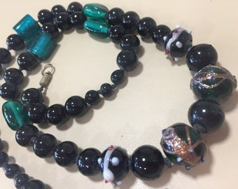 Beautiful vintage hand knotted glass beads, lamp-work and foil