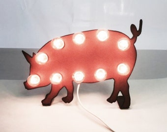 Pig Marquee lighted sign made out of rusted metal
