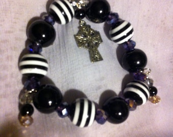 Black and white stretch beaded bracelet with Celtic cross charm