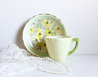 Carlton ware teacup and yellow floral saucer mismatched china