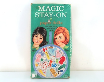 Vintage 60s paper dolls magic stay on