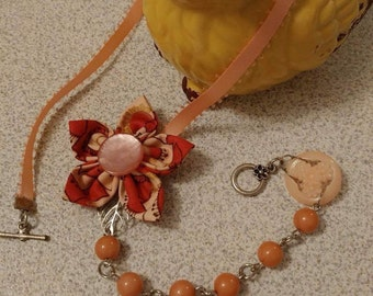 Pink fabric flower and beads necklace with vintage buttons
