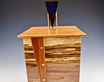 Ambrosia box with cherry lid and legs and a stunning ebony and glass finial on copper posts