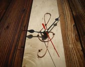 Wall clock with copper treble clef hammered       ClockTop