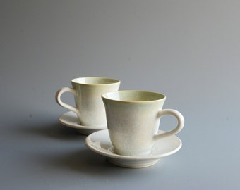 Two teacups/saucers  handthrown
