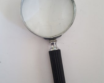 Vintage Made in USA aluminum frame magnifying glass, clean glass with no significant scratches.