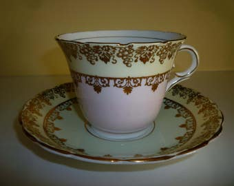 Colclough Tea Cup and Saucer ~ Beautiful Gold decorative bands w/ Pale Yellow, Pink, Green. Genuine ~ Bone China ~ Made in England