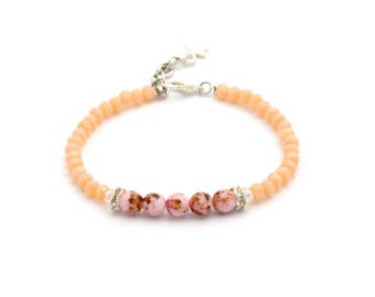 Bracelet with peach orange / pink beads