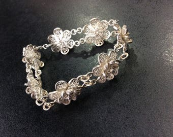 Silver filigree bracelet ,flowers