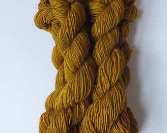 mini merino skeins of sock weight yarn, natural dye, oak and indigo