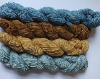 set of merino mini skeins, singles, dyed with natural material, indigo, oak