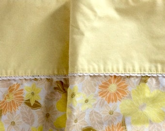 Pair of yellow floral pillowcases.....1970s...no iron percale....lace trim