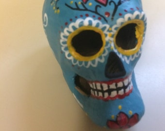 Hand-painted paper mâché turquoise sugar skull