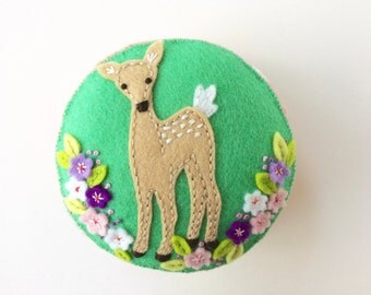 hand embroidered green and apricot wool felt pincushion with a baby deer and lots of pretty flowers