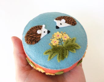 Handmade happy hedgehogs felt pincushion with hand appliquéd and embroidered flowers