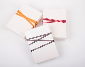 Elegant gift wrapping service with ribbons for purchase of Keiko Uchida