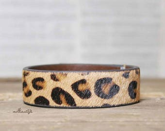 CUSTOM HANDSTAMPED narrow brown leather cuff with animal print by mothercuffer
