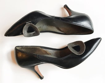 1950's black leather pumps with metal oval detailing. Size 7/7.5 narrow.