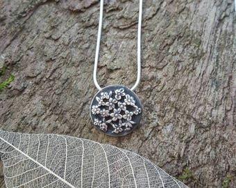 Fine silver flower detail pendant