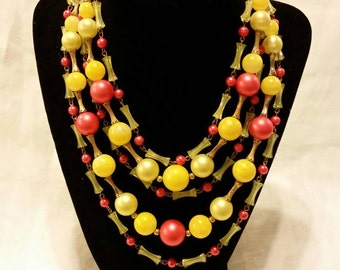 Vintage multi strand 5 row necklace yellow, coral clear and gold beads.
