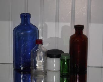 An unusual collection of 5 vintage bottles in five colors, all in good condition.