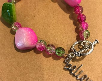 Believe pink and green bead bracelet. Proceeds benefit French Camp Academy