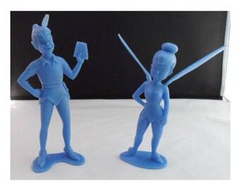 "1972 blue, hard plastic Peter Pan and Tinkerbell figurines; Louis Marx & Co.; Walt Disney Prod.; 6"" tall"